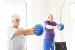 Group exercise with hand-held exercise balls
