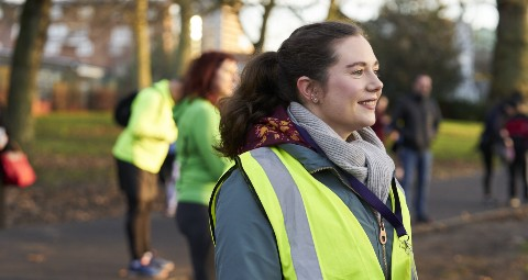 A volunteer supporting physical activity